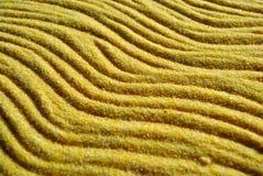 Fundo amarelo da areia com sombras do por do sol fotografia de stock royalty free