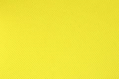Fundo amarelo do papel ondulado imagens de stock royalty free