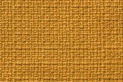 Fundo amarelo escuro de um material de matéria têxtil r backdrop foto de stock