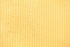 fundo amarelo textured com linhas verticais e listras do emplastro imagem de stock royalty free