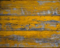 Fundo amarelo velho de pranchas de madeira pintadas imagem de stock