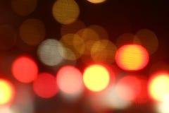Fundo amarelo vermelho colorido da luz da noite do fundo do bokeh claro colorido macio abstrato de Bokeh multi imagem de stock royalty free