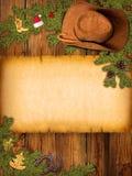 Fundo americano do Natal com chapéu de vaqueiro e papel velho Fotografia de Stock