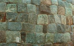 Fundo antigo da textura da parede do forte do bloco da pedra do granito Fotos de Stock