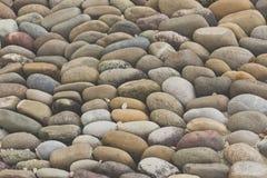 Fundo arredondado do assoalho das rochas imagens de stock