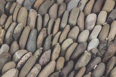 Fundo arredondado do assoalho das rochas foto de stock