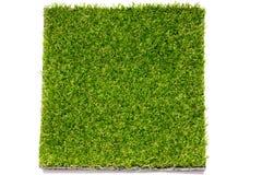 Fundo artificial verde ascendente fechado da placa da grama fotografia de stock royalty free