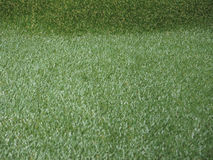 Fundo artificial verde da textura da grama Imagens de Stock Royalty Free