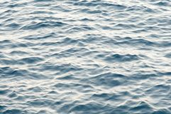 Fundo azul da superfície da água do mar Fotografia de Stock Royalty Free