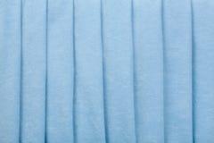 Fundo azul das dobras paralelas de veludo Fotografia de Stock Royalty Free