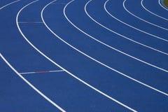 Fundo azul de uma pista Imagem de Stock Royalty Free
