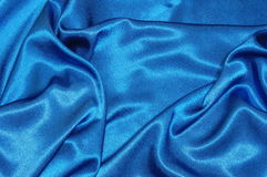 Fundo azul do cetim fotos de stock