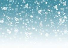Fundo azul do inverno com flocos de neve fotos de stock royalty free