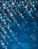 Fundo azul do Natal com estrelas da luminosidade Imagens de Stock Royalty Free
