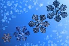 Fundo azul do Natal com uma composição das imagens dos flocos de neve imagem de stock