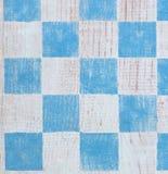Fundo azul do tabuleiro de damas Fotografia de Stock Royalty Free