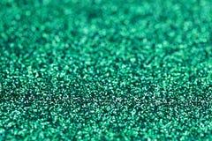Fundo azul verde do brilho da faísca de turquesa O feriado, o Natal, os Valentim, a beleza e os pregos abstraem a textura Imagens de Stock