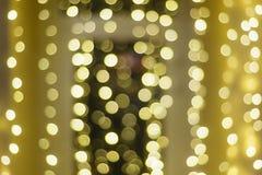 Fundo bonito do bokeh do ouro do Natal com espaço vazio da cópia imagem de stock royalty free