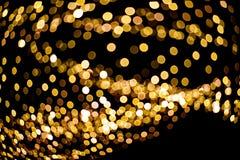 Fundo borrado dourado do feriado da iluminação do Natal das luzes foto de stock