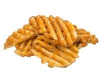 Fundo branco cortado waffle das batatas fritas Fotografia de Stock Royalty Free