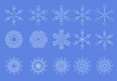 Fundo branco do azul dos flocos de neve Fotos de Stock
