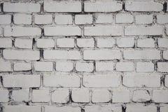 Fundo branco sob a forma de uma parede de tijolo fotografia de stock