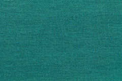 Fundo ciano claro de um material de matéria têxtil com teste padrão de vime, close up imagens de stock