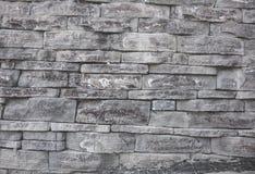 Fundo cinzento da parede da textura de pedra da alvenaria desigual foto de stock royalty free