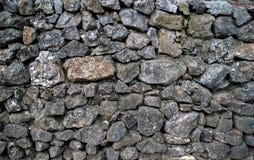 Fundo cinzento, parede áspera, de pedra foto de stock