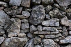 Fundo cinzento rústico da parede de pedra Fotos de Stock