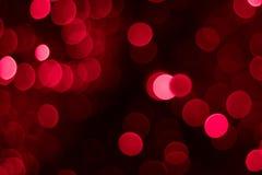 Fundo circular vermelho e cor-de-rosa abstrato do bokeh Imagens de Stock