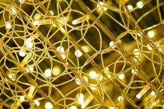 Fundo claro abstrato do bokeh do ouro no partido e no celebratio foto de stock royalty free