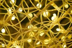 Fundo claro abstrato do bokeh do ouro no partido e no celebratio imagens de stock royalty free