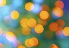 Fundo claro roxo do amarelo abstrato do verde da precipitação da cidade do borrão Imagem de Stock Royalty Free