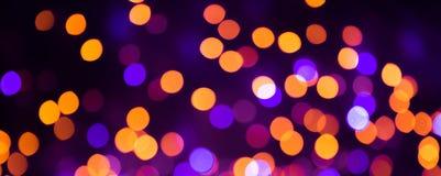 Fundo colorido do feriado com luzes brilhantes do bokeh foto de stock