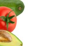 Fundo com abacate e tomate Imagem de Stock