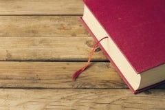Fundo com livro vermelho Imagens de Stock