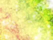 Fundo com luzes brilhantes no amarelo, no verde e na laranja Fotos de Stock