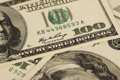 Fundo com notas de dólar do americano cem do dinheiro Foto de Stock Royalty Free