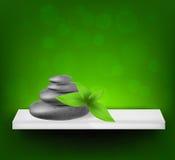 Fundo com pedras e folhas dos termas Imagens de Stock Royalty Free
