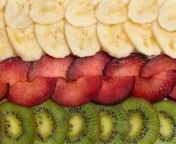 Fundo com quivi, ameixas e bananas Fotografia de Stock Royalty Free