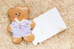 Fundo com um urso do mel-bolo Foto de Stock