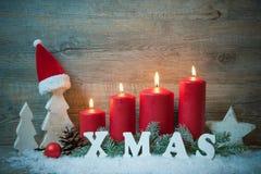 Fundo com velas e flocos de neve para o Natal Foto de Stock Royalty Free
