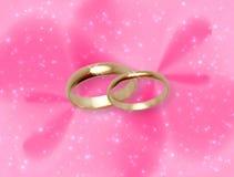 Fundo cor-de-rosa do fulgor com anéis de casamento ilustração stock