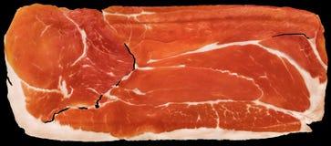 Fundo curado Prosciutto de Ham Rasher Isolated On Black da carne de porco fotografia de stock