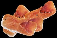 Fundo curado Prosciutto de Ham Slices Isolated On Black da carne de porco fotografia de stock