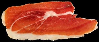 Fundo curado seco de Ham Slice Isolated On Black da carne de porco do Prosciutto fotos de stock