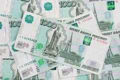 Fundo da denominação dispersada do rublo de russo das cédulas mil rublos Fotografia de Stock Royalty Free
