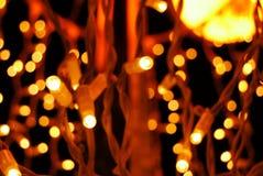 Fundo da luz amarela e alaranjada do Natal Imagem de Stock