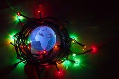 Fundo da luz de Natal de África Azia do globo da terra Imagem de Stock